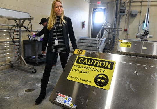 St. Cloud Public Services Director Tracy Hodel walks past an ultraviolet system used to kill bacteria and viruses Tuesday, March 17, 2020, at the St. Cloud Wastewater Treatment Plant.