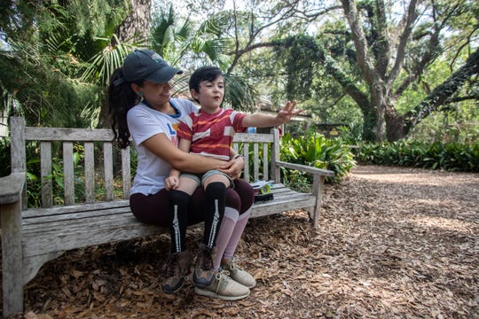 Micah Cockerham, 4, sits in his moms lap as he holds up how old he is. His mom Julie Cockerham brought him to the Tallahassee Museum for some fun during spring break, Wednesday, March 18, 2020.