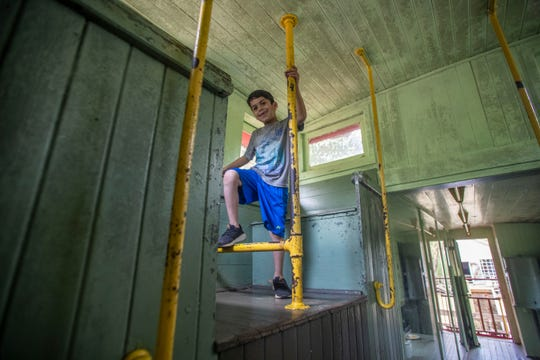 Ryan Pohlmann climbs inside a display train car at the Tallahassee Museum, Wednesday, March 18, 2020.