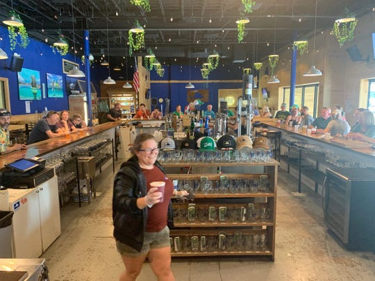 Taylor Welchel, brand manager at Sailfish Brewery in Fort Pierce, serves last call shortly after 4:30 p.m. March 17, 2020.
