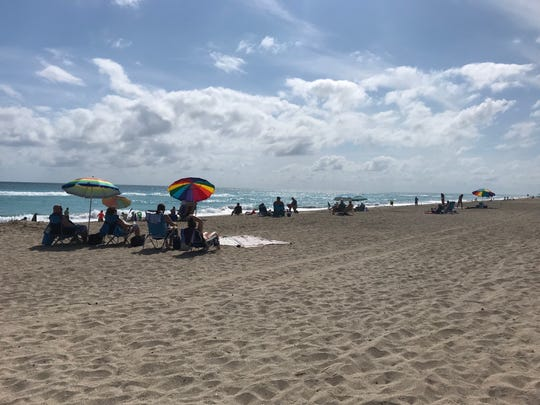 Stuart Beach was busy with about 50 cars in the parking lot on March 18. Lt. Chad Rector with Martin County Fire Ocean Rescue said the beach and water were open and would remain open until ocean rescue officials were told to close the beach because of COVID-19.