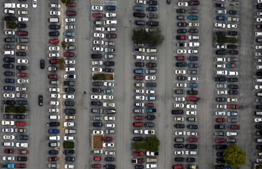 Automobiles fill the parking lot of the Treasure Coast Square Mall shopping center late morning on Black Friday, 2010 in Jensen Beach.