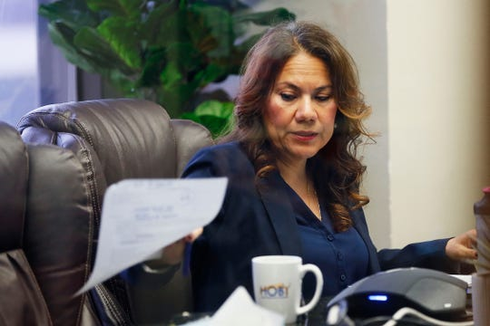 U.S. Rep. Veronica Escobar (D-El Paso) sits with only three other people in a town hall on coronavirus Wednesday, March 18, at her offices in El Paso. Few people were allowed in the room for the virtual town hall. Local health officials and experts joined her to answer questions about coronavirus.