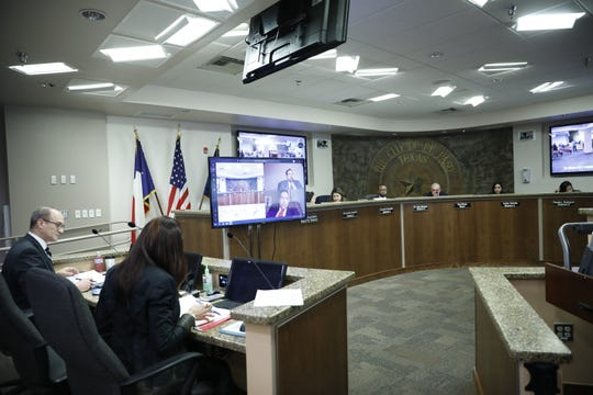 El Paso City Manager Tommy Gonzalez and District 1 city Rep. Peter Svarzbein attend Tuesday's City Council meeting by video conference software.