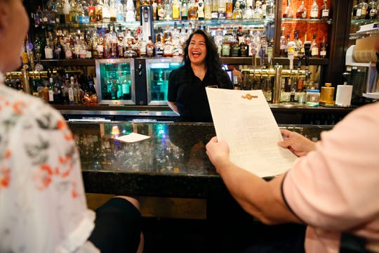 Alijan Sosa, bartender for 17 years at Mesa Street Grill, welcomes customers for the last time for a while at the restaurant Tuesday, March 17, in El Paso. Longtime West El Paso restaurant, has closed its dining rooms and has shiftedÊto curbside pickup and delivery.