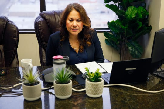 U.S. Rep. Veronica Escobar, D-El Paso, sits with only three other people during a town hall on the coronavirus Wednesday, March 18, 2020, at her offices in El Paso. Few people were allowed in the room for the virtual town hall. Local health officials and experts joined her to answer questions about the coronavirus.