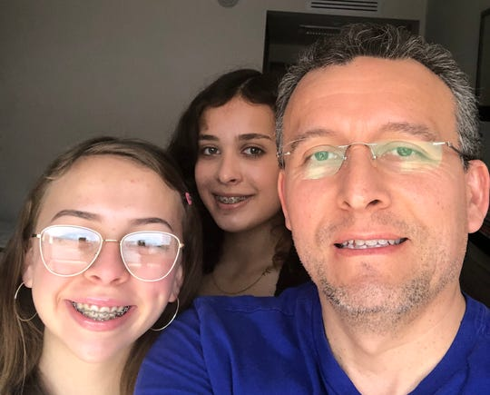 El Paso Dr. Max Peralta traveled to Peru for spring break and has been stranded there with his teenage daughters, 17-year-old Marie (front) and 16-year-old Therese (back) after the country shut its borders.