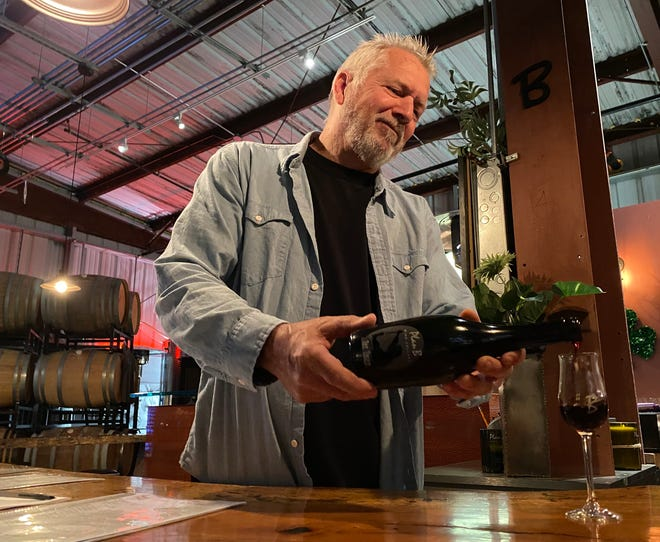 Marlow Barger of Plan B Wine Cellars in Ventura pours a sample of port before temporarily closing the tasting room at the request of Gov. Gavin Newsom. Tasting rooms at wineries and breweries throughout the state are currently closed in an effort to halt the spread of COVID-19. Some owners, like Barger, have launched to-go sales during the shutdown.