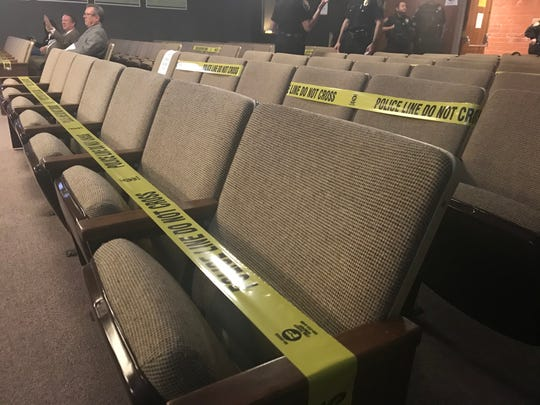Police tape sections off large portions of the Oxnard Council Chambers to indicate where the public can not sit. The social distancing measure ensures there are at least six feet of distance between two people.