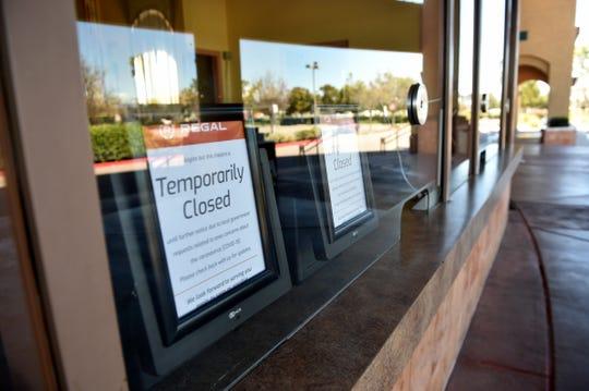 Signs tell visitors at the Regal Edwards Camarillo Palace and IMAX of the cinema's temporary closure.