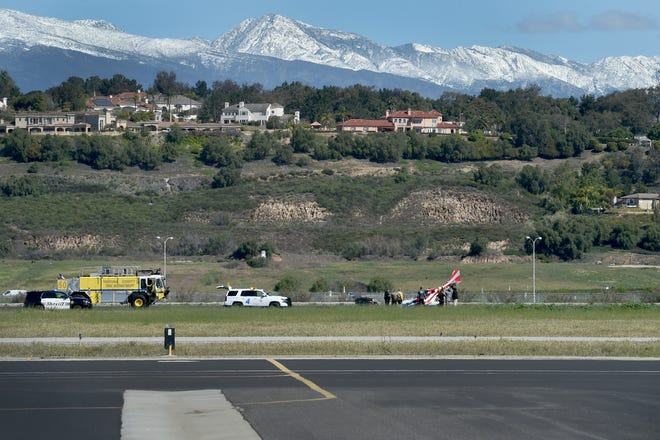 A plane sits with its nose on the runway at Camarillo Airport on Wednesday after a crash.