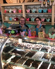 Amy Barbera, (right) owner of Barbera's Chocolate on Occasion in Vineland, (pictured with employee Val Vassallo), is trying to  balance customer demand for Easter treats with a possible store closure to comply COVID-19 related mandates.
