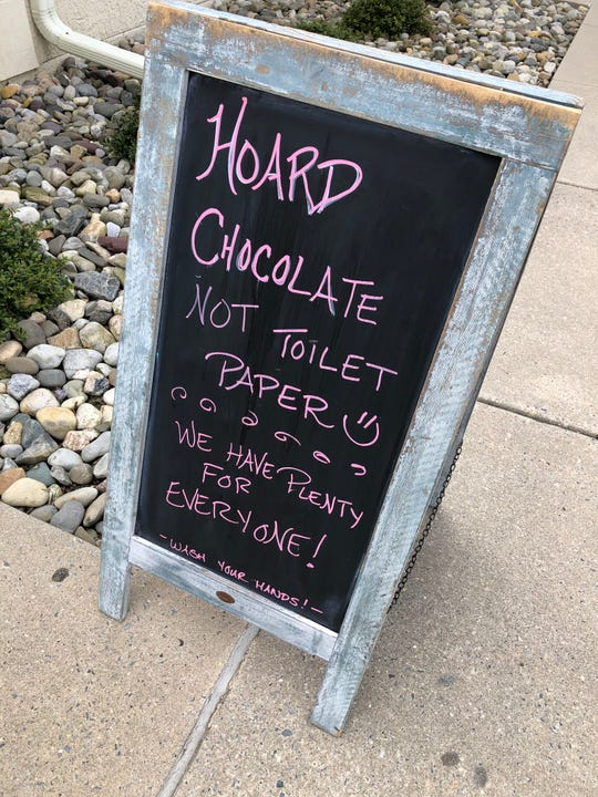 Sign, standing outside of Barbera's Chocolate on Occasion, suggests a sweet shift to shoppers stocking up to cope with possible COVID-19 related shortages.