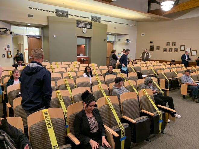 Tulare practices social distancing during a March 17, 2020 city council meeting.