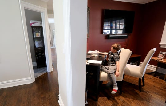 Ethan Klein, 6, does schoolwork in his family's home in Bedford, N.Y. March 18, 2020. Ethan is a first-grader at the Bedford Village Elementary School. Students of all ages have started schooling at home as schools have closed due to coronavirus concerns.