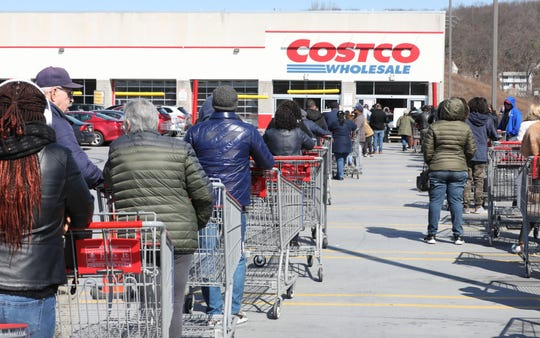 "Shoppers at the Costco in Yonkers, line up in two lines along the edge of the parking structure, as they wait to get in to shop, March 18, 2020. They were letting in a few at a time and shoppers returning to their cars, said it was a very ""pleasant shopping experience."""