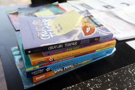 Some of fourth-grader Gavin Tecza's books are pictured at his home in Larchmont March 18, 2020. Suzanne Tecza, a library specialist at a local school, has set up a schedule to homeschool her son at home during their self-quarantine.