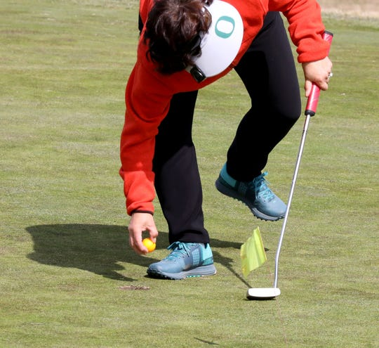 Tiny flags serve as the temporary pin markers at the Saxon Woods Golf Course in Scarsdale, March 18, 2020.