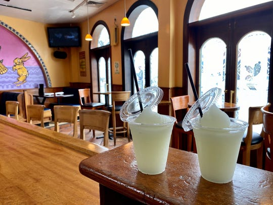 To-go cups filled with margaritas at Tequila Sunrise in Larchmont.