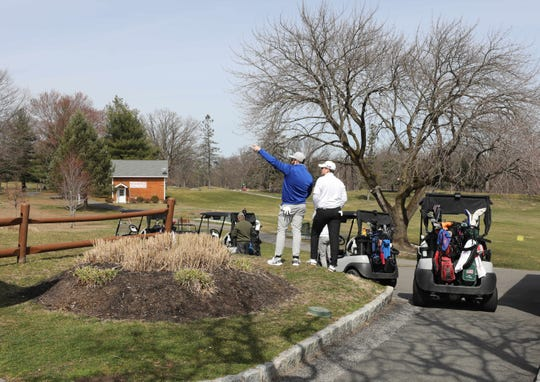 Golfers wait to tee off at the Saxon Woods Golf Course in Scarsdale, March 18, 2020.