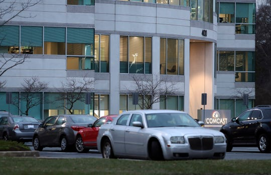 The Comcast facility in the Christiana Corporate Center early Tuesday evening, with workers' cars occupying the parking lot.