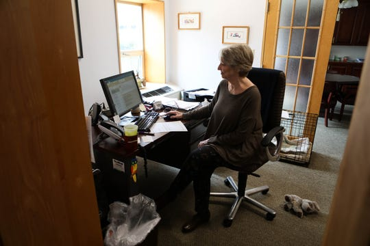 "Lucinda Ross, executive director of St. Micheal's School and Nursery, sits in her office in the empty building where childcare halted Monday. ""We're not turning our backs on our community,"" she said. ""But I'm not putting my staff or my children or my families at risk without some kind of support."""