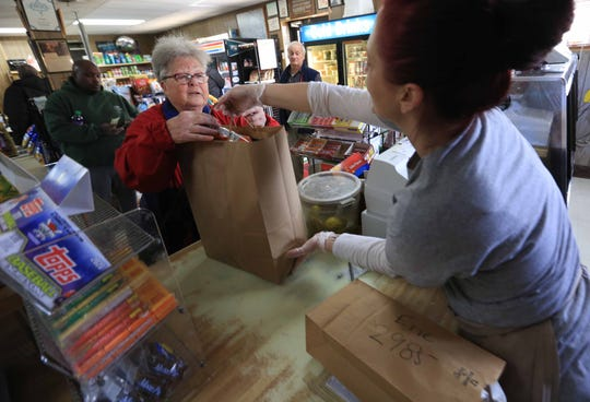 Loyal customer Bonnie Schuman, who is taking precaution against the coronavirus, still made her trip to Casapulla's Subs for sandwiches along a few other staples on Wednesday afternoon. Restaurants in Delaware are now restricted to takeout only to help reduce the spread of the coronavirus.