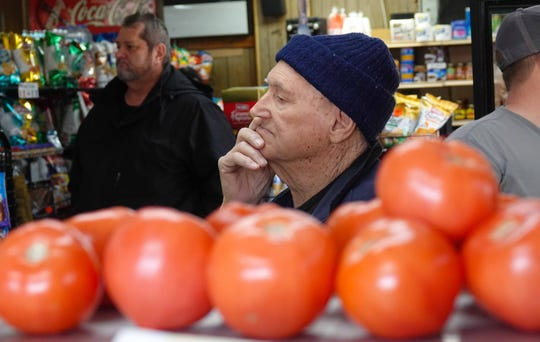 A customer waits patiently in line at Casapulla's in Elsmere on Wednesday afternoon for a takeout order.