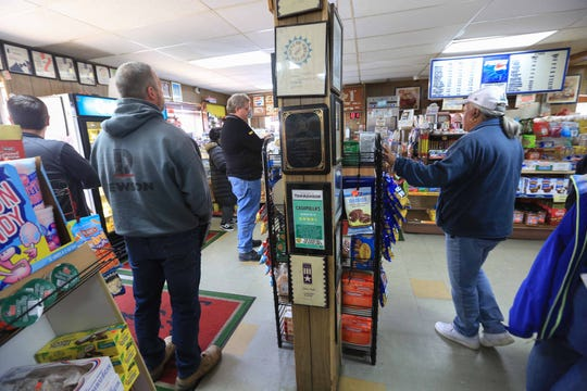 Customers lined up for subs and other food items at Casapulla's Subs in Elsmere on Wednesday afternoon. Third generation owners Lou and Annlyn Casapulla have seen about a 20 percent increase in business since restaurants have been restricted to takeout only.