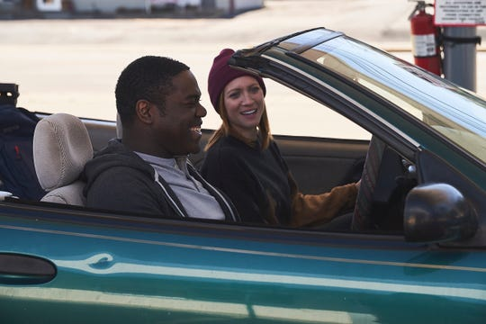 """A hopeless romantic (Sam Richardson) and a sex-addicted journalist (Brittany Snow) are the unlikely couple of the romantic comedy """"Hooking Up."""""""