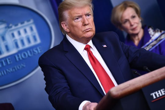 US President Donald Trump listens to a question during the daily briefing on the novel coronavirus, COVID-19, at the White House on March 18, 2020, in Washington, DC.
