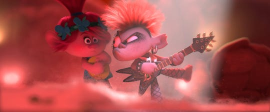 "Poppy (voiced by Anna Kendrick, left) doesn't know what to make of metalhead Barb (Rachel Bloom) in the animated sequel ""Trolls World Tour."""