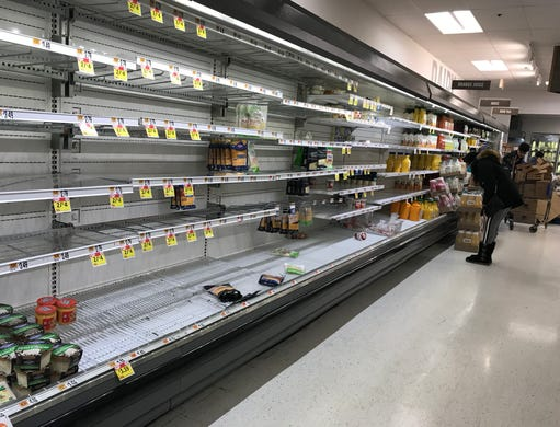 Empty cheese and dairy shelves greet customers at the Stop & Shop in Cross County Center in Yonkers, March 18, 2020.