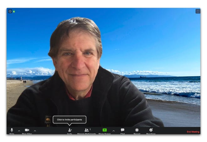 Jefferson Graham uses the background feature of the Zoom app to put him at the beach