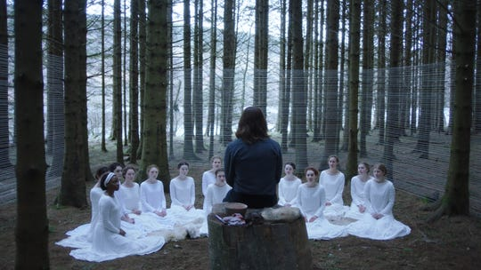 """A group of women follow a messianic figure known as Shepherd (Michiel Huisman, center) in the horror film """"The Other Lamb."""""""