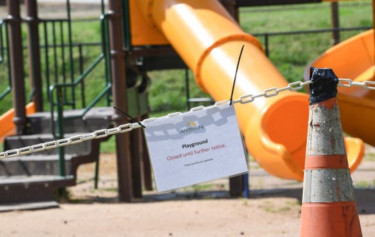 A sign on a chain blocking off playground equipment at Linley Park, one of several playgrounds and shelters closed in Anderson Thursday, March 18, 2020.