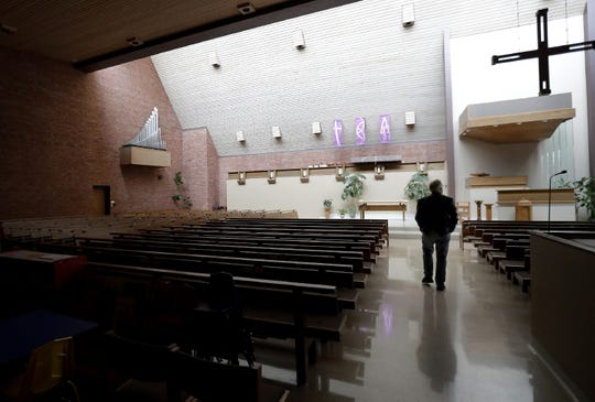 The Rev. Steve Savides walks through the church to meet with a team that is preparing a set for livestreaming services at First Congregational United Church of Christ on Wednesday in Appleton.