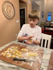 Aiden Griesemer, 10, of Barnegat rolls struffoli, also known as honey balls.
