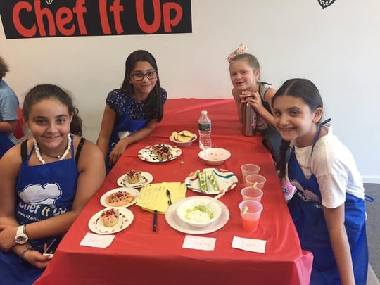 Chef It Up students with their finished dishes.