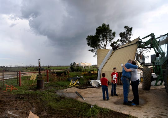 Randall Franke is hugged by his daughter after she came to check on the damage to his ranch on FM 1082. At least two tornadoes were confirmed to have struck the Abilene area earlier that morning.