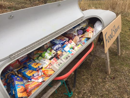 Val Rossman of Union City created a neighborhood food share pantry out of an old car top carrier for skis.