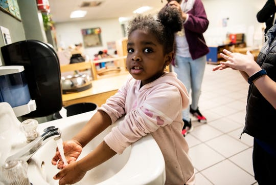 Khilee Kirk, 4, sings Twinkle Twinkle Little Star to time her handwashing on Thursday, March 19, 2020 at the YMCA in Battle Creek, Mich. As schools remain closed to slow the spread of COVID-19, the Battle creek YMCA is offering emergency relief day camp for elementary-age children, pending state and federal mandates.