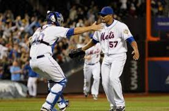 Owego's Josh Thole greets Johan Santana after Santana threw the first no-hitter in New York Mets history June 1, 2010 against the St. Louis Cardinals at Citi Field.