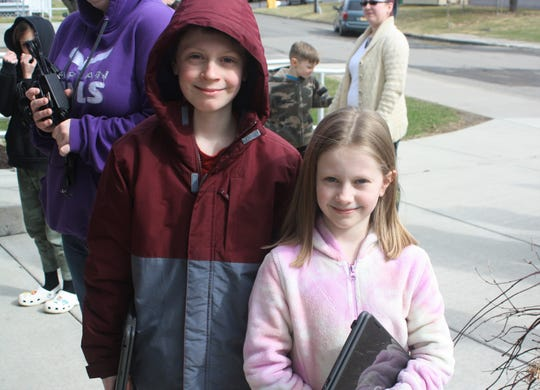 Jayden McGowan, a 10-year-old fifth-grader and Kyra McGowan, a 7-year-old second-grader, both of Endicott, received Chromebooks at Union-Endicott's Charles F. Johnson, Jr. Elementary School on March 19 to use for at-home learning.