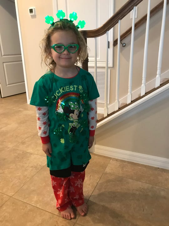 Isabella, 5, decided to put on her St. Patrick's Day outfit over her pajamas.
