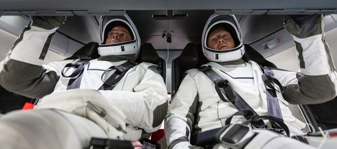 NASA astronauts Bob Behnken and Doug Hurley familiarize themselves with SpaceX's Crew Dragon, the spacecraft that will transport them to the International Space Station as part of NASA's Commercial Crew Program.