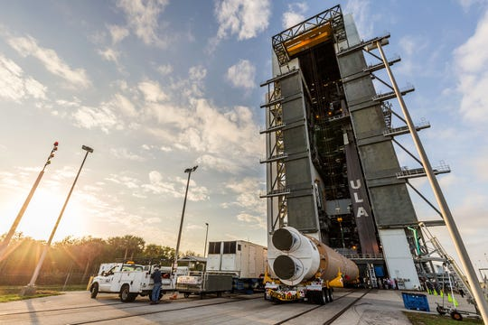 United Launch Alliance hoists its Atlas V booster onto the mobile launch platform at Cape Canaveral Air Force Station. The rocket will launch the sixth Advanced Extremely High Frequency (AEHF-6) protected communications satellite for the U.S. Space Force Space and Missile Systems Center.