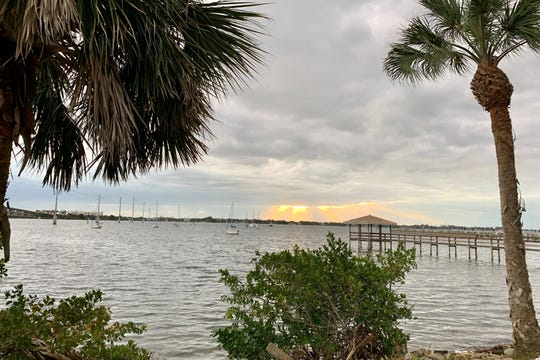 Even in this Bizarro World, the sun continues to rise over the Indian River.