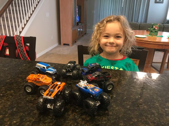 """Isabella, 5, doesn't know that her monster trucks should be practicing """"social distancing."""""""