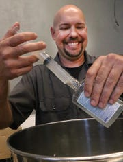 Copper Bottom Craft Distillery owner Jeremy Craig, laughs while he fills small bottles with hand sanitizer Wednesday, March 18, 2020 as the Holly Hill distillers use some of their product to make hand sanitizer and give it away to those in the community during the Coronavirus outbreak.